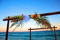 A bamboo wedding arbor can be a great addition to continue the naturalistic approach and feel of a destination wedding.