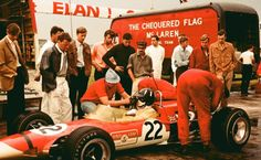 Graham Hill in the Tulln Langenlbarn, Austria paddock in July 1968. NC with insufficient laps. Rindt won the race in a Brabham BT23C. 'Chequered Flag' truck contained the McLaren M4A driven by Robin Widdows also DNF