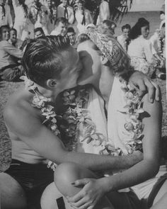 ❦ Sailor kissing girl during luau for Navy personnel on leave. Hawaii1945Eliot Elisofon