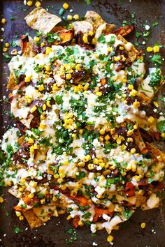 These Healthy Grilled Sweet Potato Nachos are veggie-loaded and smothered with a lighter homemade cheese sauce and tons of fresh toppings. 300 calories.
