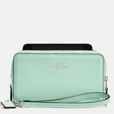 Coach Crossgrain leather double zip phone wallet Brand new with tags. Seaglass mint green with card slots and separate phone compartment. Fits iPhone 6. Sold out in stores and online. Coach Bags Clutches & Wristlets
