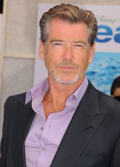 Sexy 50-something Pierce Brosnan sports a beard that's longer than scruff, but not quite a full beard.