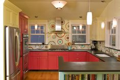 if the red was a little darker...i would really like this...especially the island bookcase for all my cookbooks!!! :D