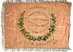 Banner of Brooks Artillery which was organized prior to the outset of the Civil War. The actions in which the unit fought are embroidered on the flag. Charleston Museum