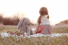 a girl and her bunny on a picnic