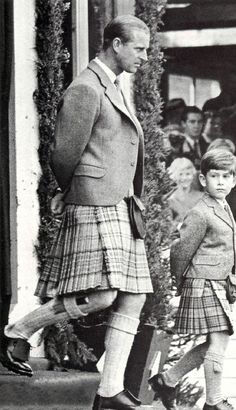 Like father, like son.  Prince Philip and Prince Charles in kilts, 1955.