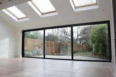 A beautiful and spacious rear kitchen extension carried out by Simply Extend to a home in Teddington. Extension Veranda, Conservatory Extension, House Extension Design, Extension Designs, Glass Extension, Roof Extension, Orangery Extension Kitchen, Living Room Extension Ideas, Patio Extension Ideas
