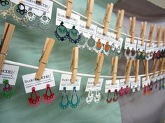 earrings display at a craft fair with mini business card