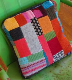 felt patchwork pillow from recycled sweaters via Etsy                                                                                                                                                     More