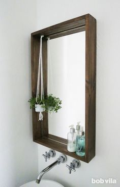 Bathroom Decor mirror Add personalityand storageto a small bath using this guide for how to frame a bathroom mirror. The ledge on this DIY framed mirror is a game-changer. Diy Bathroom, Diy Mirror, Bathroom Mirror Storage, Rustic Bathroom Shelves, Bathroom Mirror, Diy Bathroom Design, Bathroom Mirror Frame, Bathroom Design, Bathroom Decor