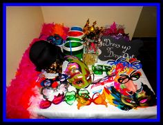 Photo props table for Mardi gras themed 30th Birthday