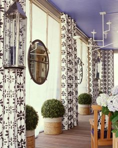 Amanda Nisbet. love the hanging mirrors from rope and classic boxwoods.