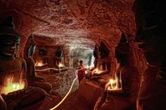 Thiha Soul: The young monk offering the candle light to the buddha images which located in Phoe Win , Myanmar , This cave is man made cave , Amazing