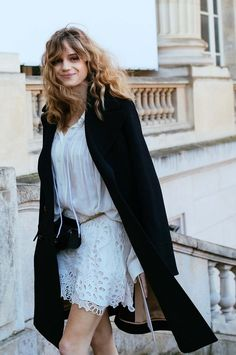 Loose soft waves, black overcoat, eyelet white dress