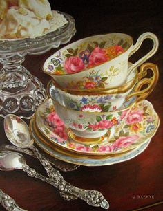 teacups and saucers silveware oil painting tea time