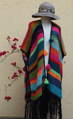 Multicolored poncho Poncho Knitted poncho by KennaInAfrica Knitted Poncho, Crochet Shawl, Knit Crochet, Free Spirit Clothing, Knitting Patterns, Crochet Patterns, Blanket Poncho, Multi Coloured Shorts, Loom Knitting Projects