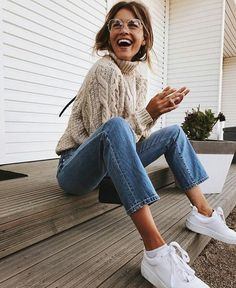 Cute chunky sweater, jeans, white sneakers.