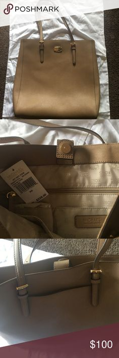 Michael Kors tote Michael Kors tote in dark Khaki leather. Comes with a pocket in the back😊 MICHAEL Michael Kors Bags Totes
