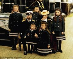 Russian Tsar Nicholas II and Tsarina Alexandra, with their five children dressed in sailing outfits (clockwise from left: Olga, Maria, Tatiana, Anastasia, Alexei). Circa, 1907.