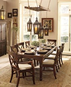 pottery barn - rustic ladder above dining room table displaying lantern lighting