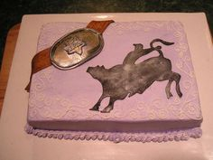 PBR birthday - 9x13 marble torted and filled w/ BC. Gumpaste belt and buckle, fondant bull and rider. I tried to girl it up a little for a bigtime female bull riding fan