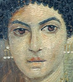 Close up of an Roman-Egyptian mummy portrait. you can really see the layers or brush strokes of the pigmented wax.