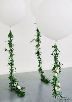 Large white wedding baloons with floral garlands