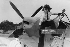 A woman of the Air Transport Auxiliary climbs into the cockpit of a spitfire. Original Publication: Picture Post - 1944 - Work Of The Ferry Pilots - pub. 1944 Get premium, high resolution news photos at Getty Images Fighter Pilot, Fighter Jets, The Spitfires, Female Pilot, Supermarine Spitfire, Battle Of Britain, Royal Air Force, Second World, Love At First Sight