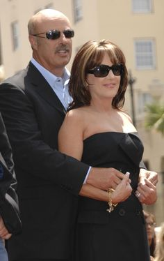 Dr. Phil and Robin McGraw I love Dr Phil for his direct approach and Robin for her elegance in clothes and life