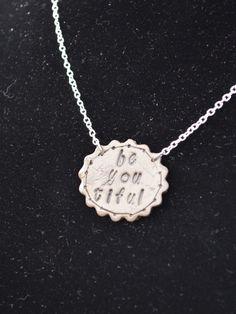 Be you tiful.   faux leather pendant necklace