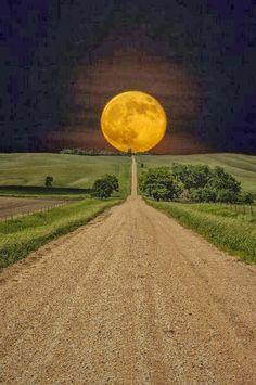 Moonrise over a road in South Dakota, USA