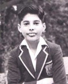 In school uniform.  He was teased and called 'Bucky' at school because of his teeth, but refused braces as a teen because he thought it would affect his voice.
