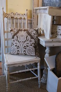 Love the pillow and chippy patina chair ~ The Cottage Blog