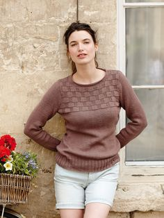 Atwood - This simple, wide neck sweater designed by Martin Storey features in the Summerlite DK collection. It has set in sleeves and a textured yoke, making it suitable for the less experienced knitter.