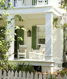 double white porches with green shutters.