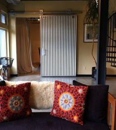 corrugated tin interior barn door by Zesty Nest via Atticmag
