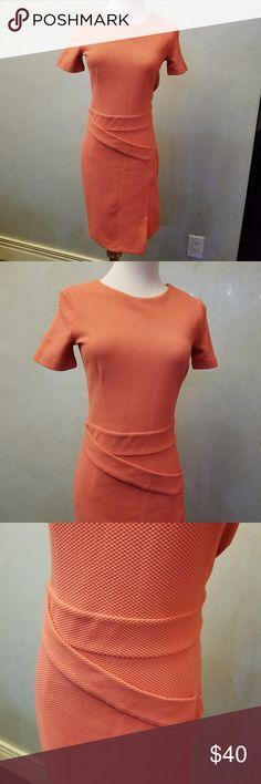 Orange short sleeve dress in perfect condition like new H&M orange short sleeve dress with a small slit on the bottom H&M Dresses Midi