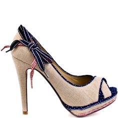 Grab your picnic basket and head out to the park with your beau in this femme sandal from Not Rated.  Strawberry Fields features a natural raffia upper with two crisscrossed straps at the vamp.  A lovely little navy polka dot trim accents this style and a decorative bow makes this one to fall head over heels in love with.  A 4½ inch heel and ½ inch platform finishes off this playful sandal.