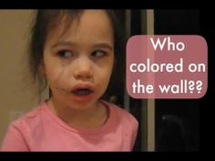 She colored on the wall, but is really more interested in capturing a kodak moment.