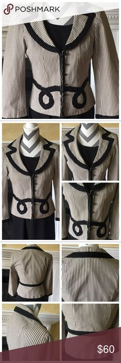 B&W Quality Blazer Black & white blazer by quality brand Nanette Lepore. Black & white pinstripes with black design on front body & around neckline. Black buttons down front of jacket for decoration - jacket closure by hidden hook & anchor on inside. Great condition, only shows signs of some general wear. Lots of photographs posted for your viewing. I did not find any specific imperfections while inspecting this garment! Great for the office or business event! More Nanette Lepore blazers in…