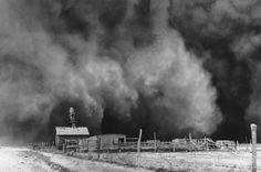 About to be engulfed in a gigantic dust cloud is a peaceful little ranch in Boise City, Oklahoma where the topsoil is being dried and blown away during the years of the Dust Bowl in central North America. Severe drought, poor farming techniques and devastating storms rendered millions of acres of farmland useless. This photo was taken on April 15, 1935.