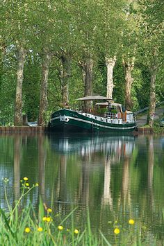 Barge cruising the Canal du Midi, France