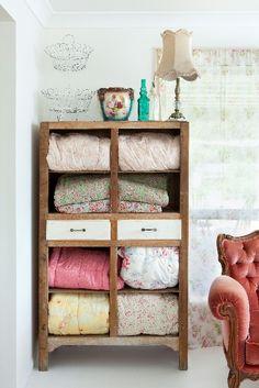 Blanket storage ideas on pinterest blanket storage for Comforter storage ideas