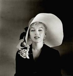 Famous photo of Marilyn in one of the most fashionable hats ever....  Well, as worn by MM, that is...  Otherwise, just a hat!