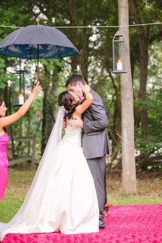 kissing in the rain. @Jodi Miller Photography