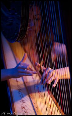 If I ever play the harp one day, I would have someone take a picture of me playing it like this