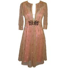 Gold lace over dress on top a pink satin slip dress