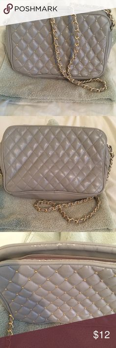 Iconic purse This purse is taupe with gold chain. Has a zippered compartment plus two open compartments. Shows a bit of wear visible in the last pic and evidenced by the price Bags