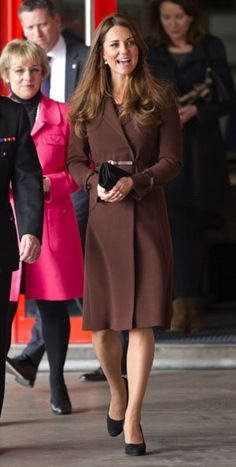 At Peaks Lane Fire Station in Grimsby, England, March 5 A wrap-style coat can also be adjusted to fluctuating sizes and held together with a sleek belt. This Hobbs Celeste style, which she's worn many times before her pregnancy, comes with a belt and retails for about $550. -