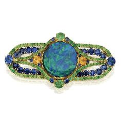 18 Karat Gold, Platinum, Opal, Sapphire, and Garnet Brooch, Louis Comfort Tiffany, Circa 1920.